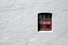 White old brick wall with window Stock Photos