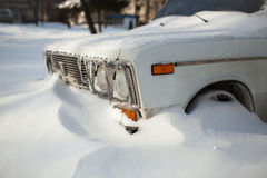 White old car covered with snow Royalty Free Stock Photo