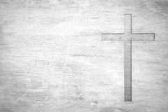 White old christian religion symbol cross shape as sign of belie. F on a grungy wood textured with copy space Stock Photos
