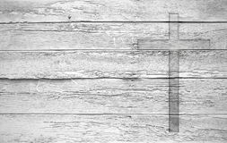 White old christian religion symbol cross shape as sign of belie. F on a grungy wood textured with copy space Stock Photo