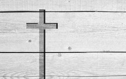 White old christian religion symbol cross. Shape as sign of belief on a grungy textured church wall or rustic aged background or ba royalty free stock photos