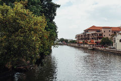 White old colonial style building with painted graffiti near the river in Melaka City, Melaka, Malaysia Royalty Free Stock Photo