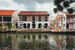 White old colonial style building with painted graffiti near the river in Melaka City, Melaka, Malaysia Stock Image
