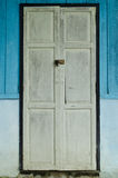 White old door. And blue wall Royalty Free Stock Photos