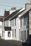 White old facades in St Margareth Hope. Orkney. Scotland Royalty Free Stock Image