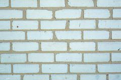 White old faded bricks background with flaws and splits. On it surface royalty free stock image