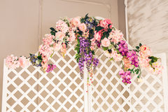 White old-fashioned folding screen decorated flowers Stock Photos