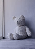 White old fashioned teddy bear sitting alone home Stock Photo