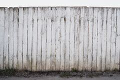 Free White Old Fence From Boards, Peeling Paint, Uneven Fencing Texture, High Protection Royalty Free Stock Image - 189972516