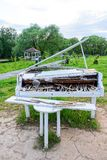 White piano in the street Stock Images