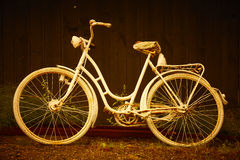 White old rusty bike in warm golden tone. Vintage background. Royalty Free Stock Image