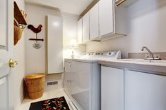 White old style laundry room interior with tile floor. Royalty Free Stock Images