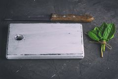 White old vintage kitchen cutting board. And bunch with green sorrel leaves, top view Royalty Free Stock Images