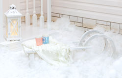 White old vintage sleigh with fur standing near the house in the snow in winter. Christmas decorations. Stock Images