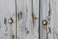White old vintage wall. Close up white old vintage fence with rusty nails Stock Image