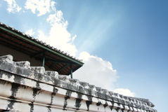 White old wall of asian temple on hill. With afternoon  blue  sky Stock Images