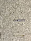 Scratched wall. A white old wall which has some scratches and stickers looks dirty Stock Image