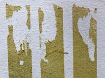 Scratched wall. A white old wall which has some scratches and stickers looks dirty Royalty Free Stock Image