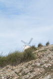 White old windmill on the hill near Consuegra. Castilla La Mancha, Spain, a symbol of region and journeys of Don Quixote Alonso Quijano on cloudy day Royalty Free Stock Photography