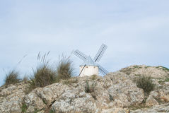 White old windmill on the hill near Consuegra. Castilla La Mancha, Spain, a symbol of region and journeys of Don Quixote Alonso Quijano on cloudy day Stock Images