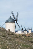 White old windmills on the hill near Consuegra. Castilla La Mancha, Spain, a symbol of region and journeys of Don Quixote Alonso Quijano on cloudy day Stock Image