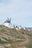 White old windmills on the hill near Consuegra. Castilla La Mancha, Spain, a symbol of region and journeys of Don Quixote Alonso Quijano on cloudy day Royalty Free Stock Photography