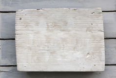 White Old Wooden Plate. Vintage white and clean wooden plate with some nails in it Royalty Free Stock Photos