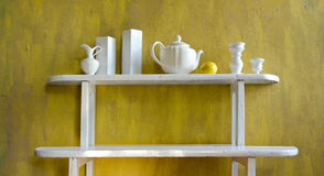 White old wooden shelf with dishes Royalty Free Stock Images