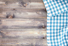 White old wooden table with blue checkered tablecloth, top view with copy space Stock Image