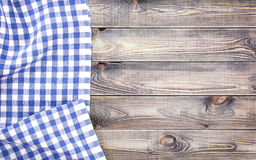 White old wooden table with blue checkered tablecloth, top view with copy space Stock Photos