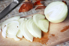 White onion. Close up view of sliced onion on wooden cutting board Stock Photography