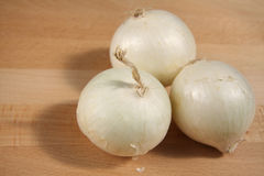 White onions. On a cutting board Royalty Free Stock Photo