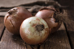 White Onions. Some white Onions (close-up shot) on vintage wooden background Royalty Free Stock Photo