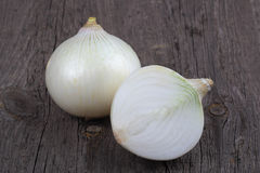 White onions on wood background Stock Images
