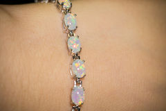 White Opal Bracelet. Fashion silver bracelet with white fire opals Royalty Free Stock Image