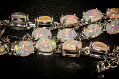 White Opal Bracelet. Fashion silver bracelet with white fire opals Stock Image