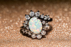 White Opal Ring. Fashion ring decorated with white fire opal stones royalty free stock image