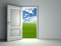 White open door. Inside empty room with view to green field and cloud sky background Stock Photo