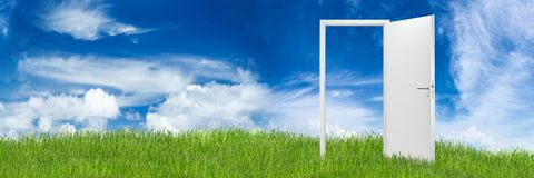 White open door concept. White open door on green grass landscape in front of blue cloudy sky change wide panorama concept background royalty free stock photography