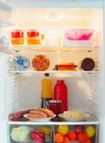 Open refrigerator with food. The white open refrigerator with food Stock Photography