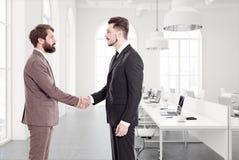 White open space office, concrete floor, handshake Stock Images