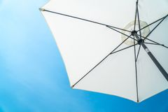 The white opened beach umbrella on a background of the blue sky Royalty Free Stock Photography