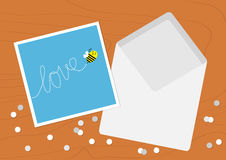 White Opened Blank Envelope letter and greeting card with flying bee insect, dash line word Love. Confetti on wood table wooden. Texture desk background. Flat Stock Photography
