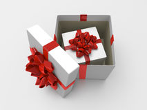 White opened giftbox with box inside. White opened giftbox with red ribbon and smaller box inside it. Inside box is covered by rough gray paper vector illustration