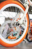 White orange bicycle in bike shop Stock Image