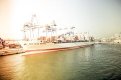 White and Orange Cargo Ship Docking during Daytime royalty free stock photo