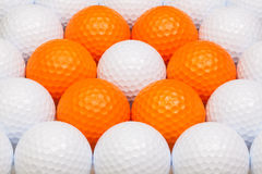 White and orange golf balls in the box Royalty Free Stock Image
