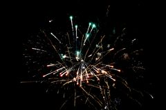 White and orange pyrotechnic fireworks in the night royalty free stock images