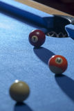White, orange and red billiard balls in a pool table Stock Image