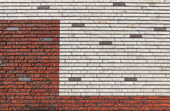 White and orange red brick wall interspersed with some gray bric Royalty Free Stock Photography